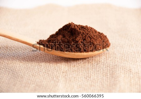 Coffee made from fresh ground on a wooden spoon. #560066395