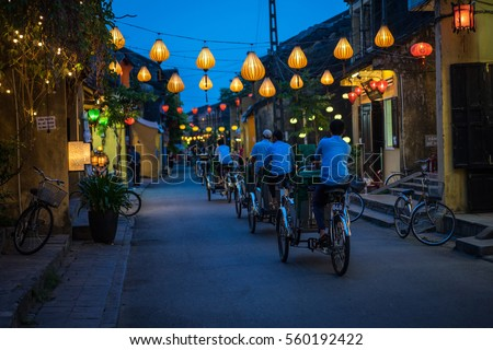 Night view of busy street in Hoi An, Vietnam. Hoi An is the World's Cultural heritage site, famous for mixed cultures and architecture. Royalty-Free Stock Photo #560192422