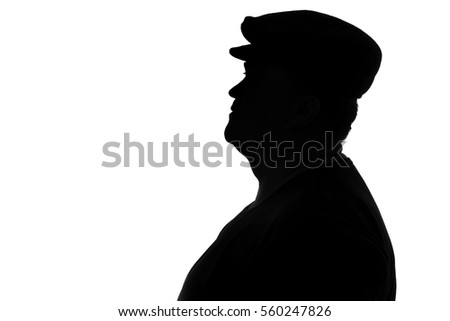 black and white silhouette of a plump man in a cap with a visor looking in profile #560247826