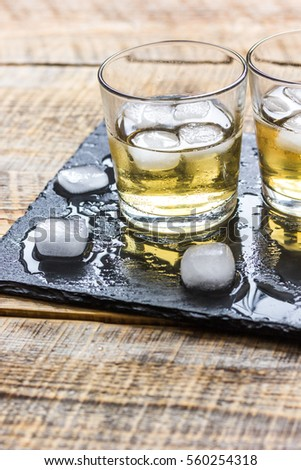 glass of whiskey on wooden background #560254318