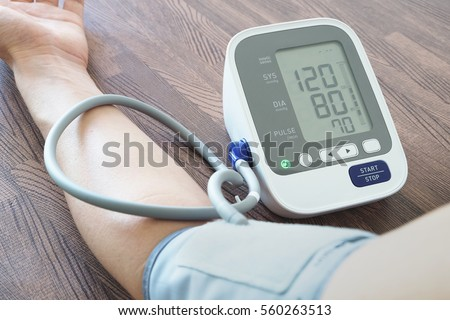Men's health check blood pressure.and heart rate with digital pressure gauge  standard blood pressure test results .Health and Medical concept #560263513