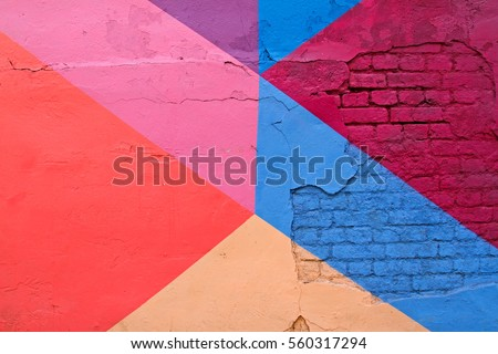 Colorful (purple, blue pink and beige) brick wall as background, texture #560317294