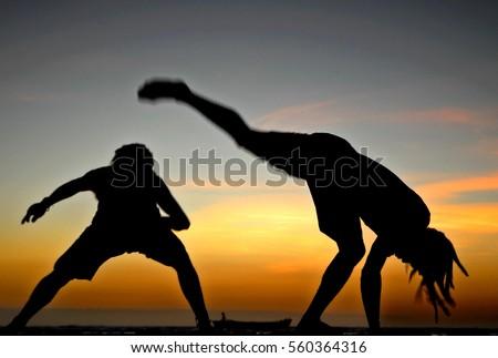 Brazil - Capoeira dancer in jericoacoara beach during the sunset #560364316