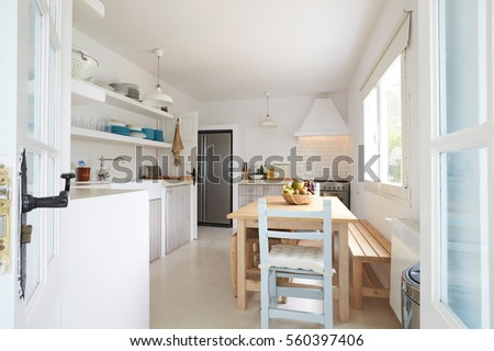 Modern Kitchen Viewed Through Open French Windows #560397406