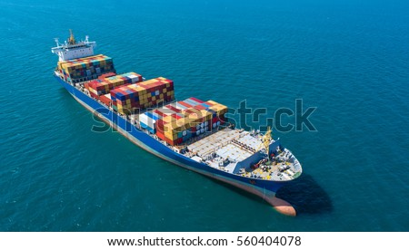 Container ship in export and import business and logistics. Shipping cargo to harbor by crane. Water transport International. Aerial view #560404078