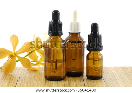 Three brown bottle with a liquid medicine with orchid #56041480