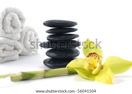 spa concept with yellow orchid and stones with roller towel #56041504