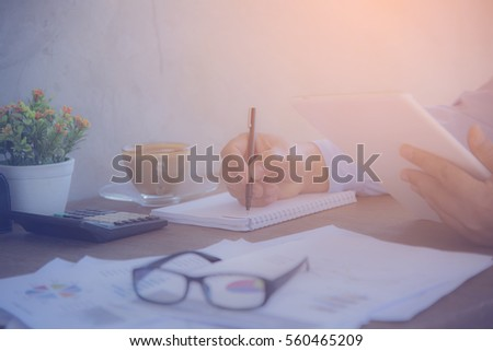 Hands of Businessman working on Laptop Computer with Data Charts #560465209