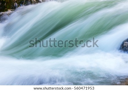 Abstract background of water Vintgar Gorge near Bled, Slovenia #560471953