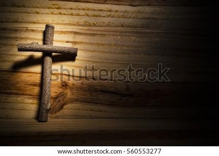 Cross wood, black background, light