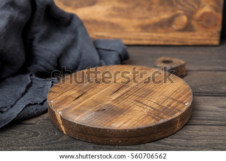 Empty vintage cutting board on dark wooden planks food background concept #560706562
