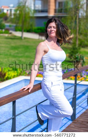 Woman in garden #560771272