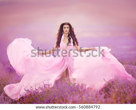 Beautiful Bride in wedding day in lavender field. Newlywed woman in lavender flowers. #560884792