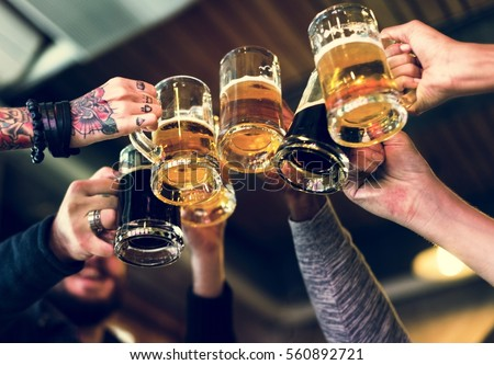 Hands Hold Beverage Beers Bottle Cheers Royalty-Free Stock Photo #560892721