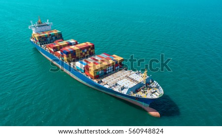 Container ship in export and import business and logistics. Shipping cargo to harbor by crane. Water transport International. Aerial view #560948824