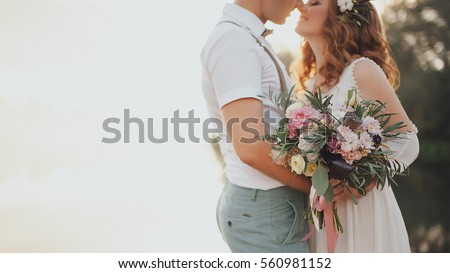 the bride and groom on the background of a mountain stream Royalty-Free Stock Photo #560981152