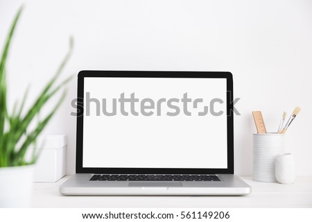 Stylish workspace with laptop computer, office supplies aloe vera plant at home or studio. Mock up. Royalty-Free Stock Photo #561149206