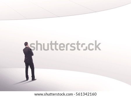 Young sales business person in elegant suit standing with his back in empty white space background with curved lines concept #561342160