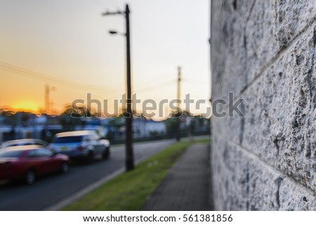 Cement bricks near to the street parking area with sunset bokeh background. #561381856