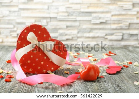 St. Valentines Day concept. Gift box and decorations on wooden table #561422029
