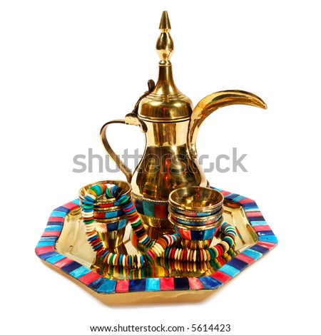 Golden pot & cups . Isolated on white.