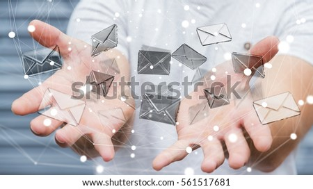 Businessman on blurred background holding 3D rendering flying email icon in his hand #561517681