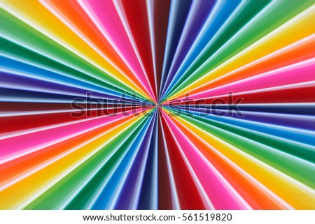 Background of colorful radial rays going from the center. Soft focus, selective focus.