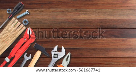 Set of hand tools on wooden background #561667741
