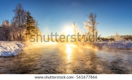spring morning landscape with fog and a forest on the shore of a lake, Russia, the Urals, February #561677866