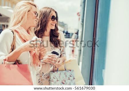 Young attractive girls with shopping bags in the city. #561679030