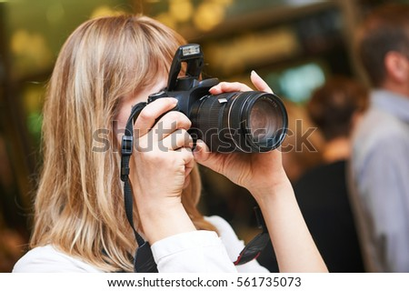 photographer woman at work indoors #561735073