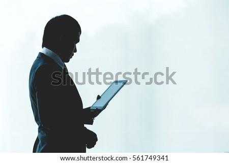 Working women are using a tablet in the office.silhouette #561749341