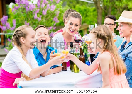 Friends and neighbors toasting on garden party #561769354