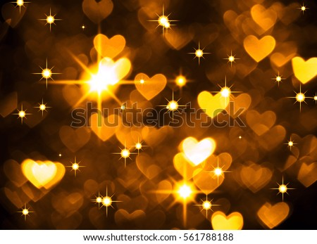 Heart background boke photo, dark yellow color. Abstract holiday, celebration and valentine backdrop.