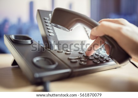 Dialing telephone keypad concept for communication, contact us and customer service support Royalty-Free Stock Photo #561870079