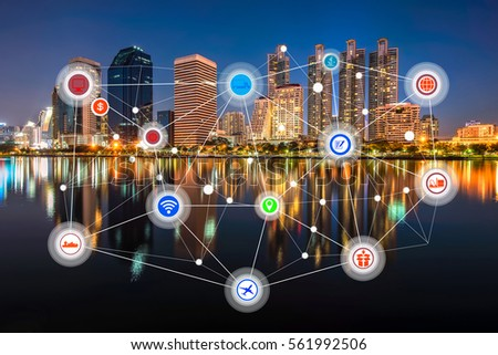 Smart city and wireless communication network, business district with office building, abstract image visual, internet of things concept #561992506