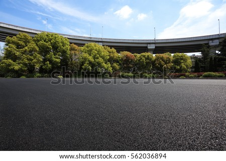 Empty road floor surface with city viaduct overpass bridge background #562036894