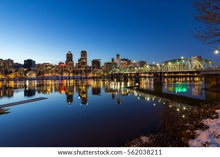 Portland Oregon downtown skyline along Willamette River winter night scene