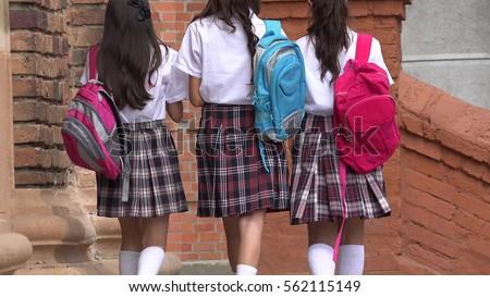 School Girls Walking With Backpacks #562115149