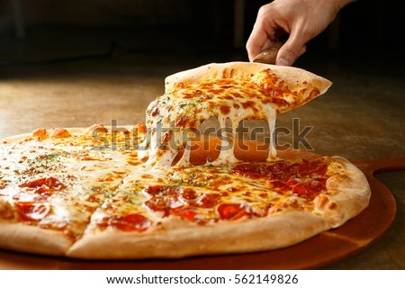 pepperoni pizza on wooden board #562149826