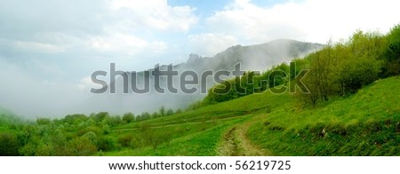 Panorama of Beautiful Mountain Landscape with Low Clouds #56219725