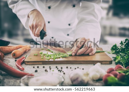 chef cooking food kitchen restaurant cutting cook hands hotel man male knife preparation fresh preparing concept - stock image #562219663