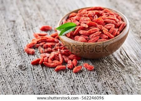 Goji berries on a wooden background #562246096