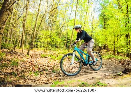 Young Woman Riding Her Mountain Bike #562261387