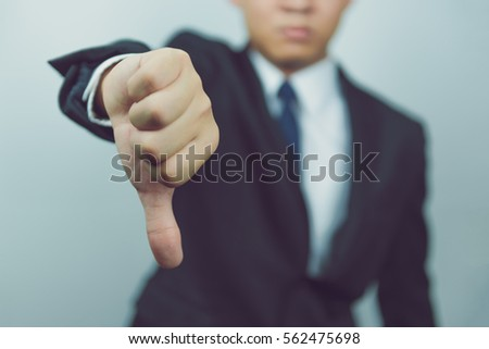 Business man  show thumbs down #562475698