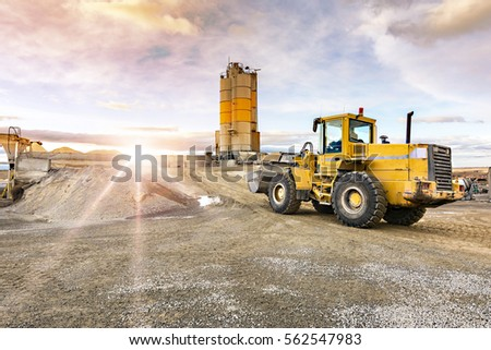 Quarry aggregate with heavy duty machinery. Construction industry. Horizontal #562547983