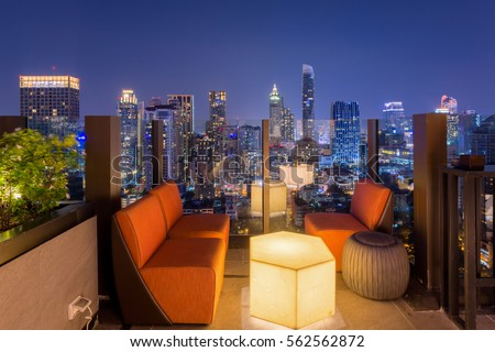 Bangkok city view point from rooftop of building in the Bangkok city downtown in blue sky and city light, Bangkok is the most populated city in Southeast Asia.  #562562872