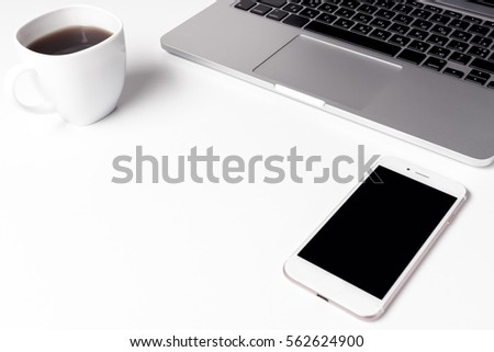 Cup With Coffee And Notebook With Pen Near Laptop At Working Space #562624900