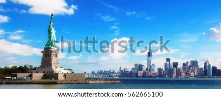 Panorama on the Statue of Liberty and the Skyline of Manhattan, New York City, United States Royalty-Free Stock Photo #562665100