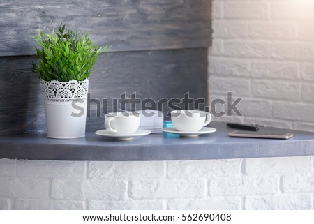 Coffee brake set: two cups of coffee with flower and mobile. Business relax concept #562690408